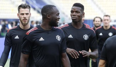 Manchester United's David de Gea, left, Romelu Lukaku, center and Paul Pogba, right, attend a training session at Philip II Arena in Skopje, Macedonia, Monday, Aug. 7, 2017, a day ahead of UEFA Super Cup final soccer match with Real Madrid. (AP Photo/Boris Grdanoski)