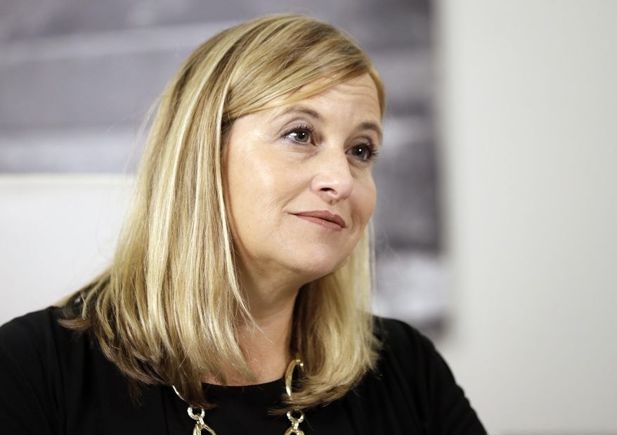 Nashville Mayor Megan Barry listens to a question during a news conference in her office Monday, Aug. 7, 2017, in Nashville, Tenn. Barry held the news conference on her first day back at work since her son's shocking death July 29 from a drug overdose. (AP Photo/Mark Humphrey)