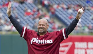 FILE- In this May 15, 2016, file photo, former Philadelphia Phillies' Darren Daulton comes out for a ceremonial first pitch before a baseball game in Philadelphia. Daulton, the All-Star catcher who was the leader of the Phillies' NL championship team in 1993, has died. He was 55. (AP Photo/Chris Szagola, File)
