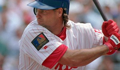 FILE- In this April 19, 1994, file, photo, Philadelphia Phillies' Darren Daulton bats against the Los Angeles Dodgers in Philadelphia. Daulton, the All-Star catcher who was the leader of the Phillies' NL championship team in 1993, has died. He was 55. (AP Photo/George Widman, File)