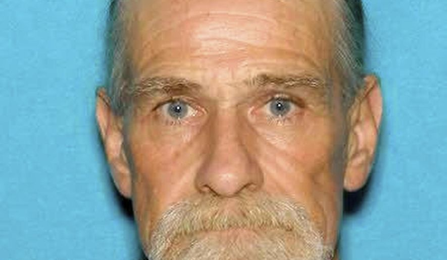 In this July 2013, Oregon driver's license photo released by the Powell County Sheriff's Office shows Mark William Collins. Collins was shot by Powell County sheriff's deputy last Friday, Aug. 4, 2017, after deputy officers and witnesses said Collins drove on the wrong way on the interstate, ran a vehicle off the road, rammed a patrol car and tried to ram another vehicle from behind. Collins was shot as he sped toward a deputy in his van north of Deer Lodge, Mont. Collins remained hospitalized in intensive care in Missoula, Mont., on Monday, Aug. 7, but apparently didn't suffer any life-threatening injuries. No charges have been filed. (Powell County Sheriff's Office via AP)