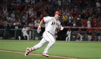 Los Angeles Angels' Mike Trout runs to first base after hitting a double, the 1000th hit of his career, during the fourth inning of a baseball game against the Baltimore Orioles, Monday, Aug. 7, 2017, in Anaheim, Calif. (AP Photo/Jae C. Hong)