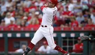 Cincinnati Reds first baseman Joey Votto (19) follows through on an RBI single off San Diego Padres starting pitcher Jhoulys Chacin during the first inning of a baseball game, Monday, Aug. 7, 2017, in Cincinnati. (AP Photo/Gary Landers)