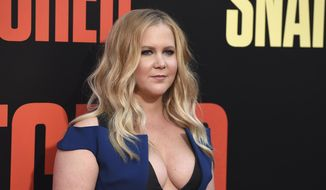 """In this Wednesday, May 10, 2017, file photo, Amy Schumer arrives at the Los Angeles premiere of """"Snatched"""" at the Regency Village Theatre. The actress and comedian will star in Steve Martin's four-person comedy """"Meteor Shower"""" at the Booth Theatre starting in November. It's about two couples who get together to observe the celestial event that inspires the title. (Photo by Jordan Strauss/Invision/AP, File)"""