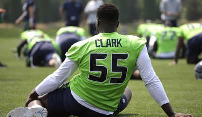 Seattle Seahawks defensive end Frank Clark (55) stretches during warmups before NFL football training camp, Monday, Aug. 7, 2017, in Renton, Wash. (AP Photo/Ted S. Warren)