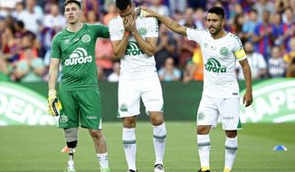 Chapecoense's Follmann, left, Neto, center, and Alan Ruschel react prior of the Joan Gamper trophy friendly soccer match between FC Barcelona and Chapecoense at the Camp Nou stadium in Barcelona, Spain, Monday, Aug. 7, 2017. (AP Photo/Manu Fernandez)