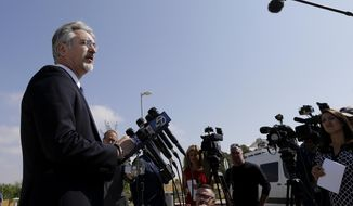 Attorney Kenneth Wine, representing Wyndham Lathem, a Northwestern University microbiologist suspected in the stabbing death of a 26-year-old Chicago man, speaks to reporters outside of the East County Hall of Justice in Dublin, Calif., Monday, Aug. 7, 2017. Lathem and Oxford University financial officer, Andrew Warren, were sought in a cross-country chase on first-degree murder charges in the death of Trenton James Cornell-Duranleau. (AP Photo/Jeff Chiu)