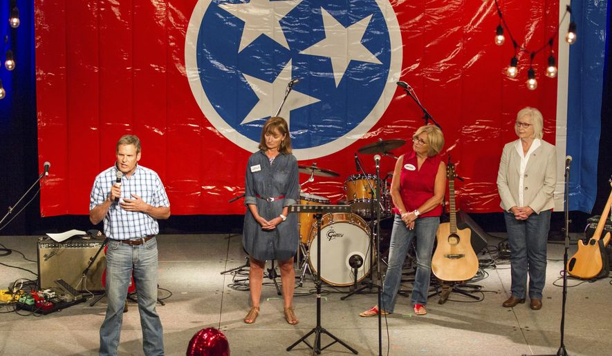 Businessman Bill Lee, left, speaks a Republican candidate for Tennessee governor, speaks at a fundraiser in Franklin, Tenn., on Sunday, Aug. 6, 2017. To his right are fellow candidates House Speaker Beth Harwell, U.S. Rep. Diane Black and state Sen. Mae Beavers. With the field largely set, some of the candidates have begun taking aim at each other in public appearances. (AP Photo/Erik Schelzig)