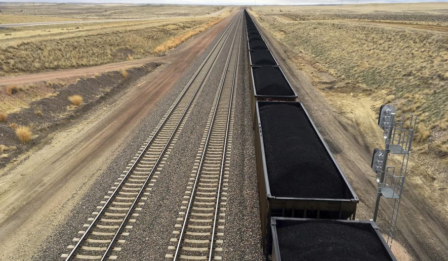 FILE - In this March 28, 2017, file photo, a train near hauls coal mined from Wyoming's Powder River Basin near Bill, Wyo. he Interior Department has scrapped an Obama-era rule aimed at ensuring that coal companies don't shortchange taxpayers on huge volumes of coal extracted from public lands, primarily in the West. (AP Photo/Mead Gruver, File)
