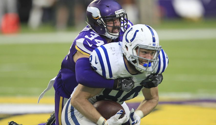 FILE - In this Dec. 18, 2016, file photo, Indianapolis Colts tight end Jack Doyle (84) catches a pass as Minnesota Vikings safety Andrew Sendejo (34) defends during the second half of an NFL football game in Minneapolis. The Vikings have finally stopped looking for a strong safety: Sendejo has played well enough over the years to keep it. (AP Photo/Andy Clayton-King, File)