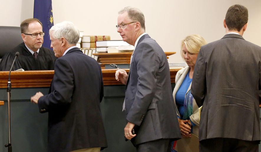Hillsborough County Superior Court Judge Charles Temple, left, looks on after a sidebar breaks up with with Attorney Paul Twomey, second left, Attorney William Christie, Associate Attorney General Anne Edwards, and Assistant Attorney General Francis Fredericks, right, Monday, Aug. 7, 2017, in Hillsborough Superior Court in Nashua, N.H., on a lawsuit that would prevent the state from sending voter information to President Donald Trump's commission investigating election fraud. (AP Photo/Mary Schwalm, Pool)