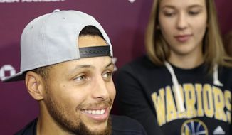 Golden State Warriors' Stephen Curry smiles while speaking to reporters at his basketball camp in Walnut Creek, Calif., Monday, Aug. 7, 2017. (AP Photo/Jeff Chiu)