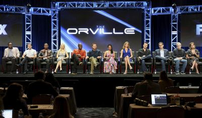 "Chad L. Coleman, from left, Mark Jackson, J. Lee, Halston Sage, Peter Macon, Scott Grimes, Penny Johnson Jerald, Adrianne Palicki, Seth MacFarlane, David A. Goodman, Brannon Braga and Liz Heldens participate in the ""The Orville"" panel during the FOX Television Critics Association Summer Press Tour at the Beverly Hilton on Tuesday, Aug. 8, 2017, in Beverly Hills, Calif. (Photo by Willy Sanjuan/Invision/AP)"