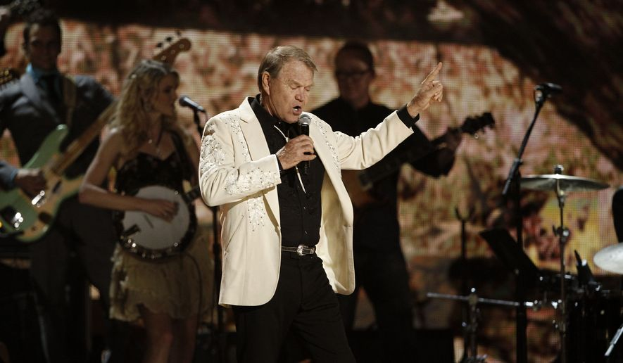 Glen Campbell performs during the 54th annual Grammy Awards on Sunday, Feb. 12, 2012 in Los Angeles. (AP Photo/Matt Sayles)