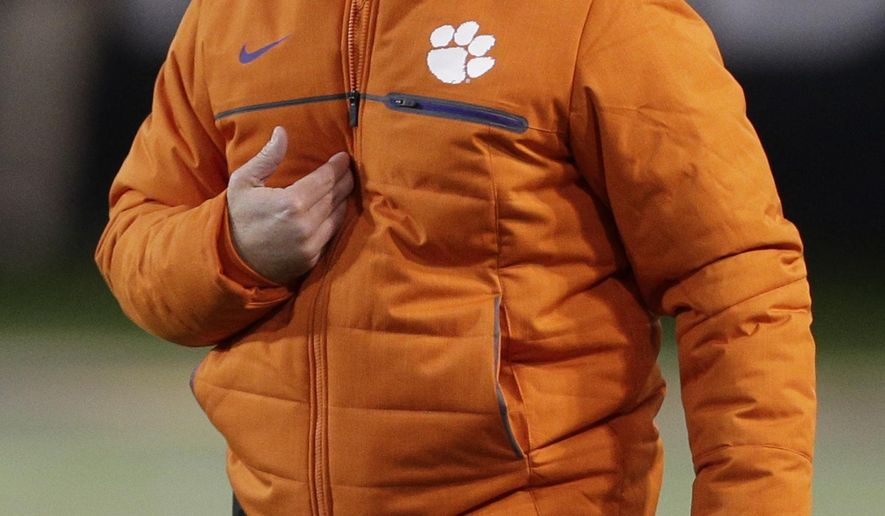 FILE - In this Nov. 19, 2016, file photo, Clemson head coach Dabo Swinney shouts to officials in the first half of an NCAA college football game against Wake Forest in Winston-Salem, N.C. The Tigers enter 2017 as the reigning national champion and a contender for the Atlantic Coast Conference title. (AP Photo/Chuck Burton, File)