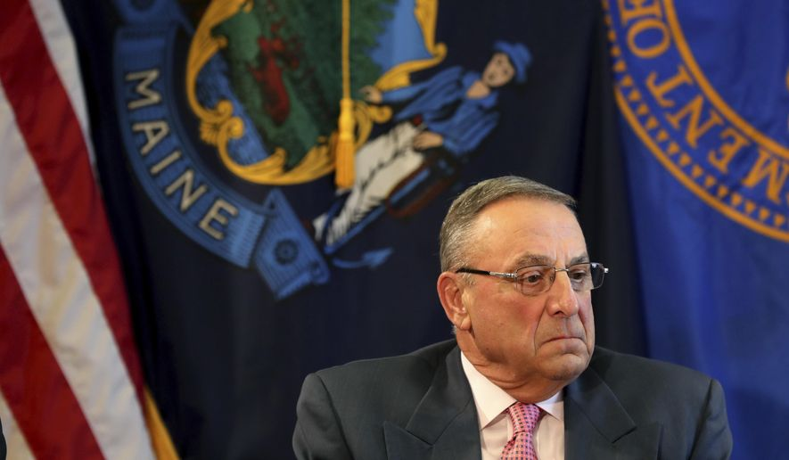 FILE- In this May 10, 2017, file photo, Maine Gov. Paul LePage pauses during a meeting to discuss the state's efforts to fight the opioid epidemic at the State House in Augusta, Maine. The American Civil Liberties Union of Maine sued LePage on Tuesday, Aug. 8, 2017, for blocking critics on his official Facebook page and deleting their comments. The ACLU filed the federal lawsuit on behalf of two women, saying their First Amendment rights were violated.  (AP Photo/Robert F. Bukaty, File)