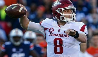 FILE - In this Oct. 22, 2016, file photo, Arkansas quarterback Austin Allen (8) throws a pass against Auburn during the first half of an NCAA college football game, in Auburn, Ala. After a successful first season as the starting quarterback at Arkansas for Austin Allen, the senior enters this season with a resume equal to nearly any other signal caller in the country. Both he and Razorbacks coach Bret Bielema know, however, that the national recognition isn't likely to come until Arkansas starts winning more games. (AP Photo/Butch Dill, File)
