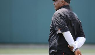 Cincinnati Bengals head coach Marvin Lewis observes practice during Cincinnati Bengals training camp practice, Saturday, Aug. 5, 2017, at Paul Brown Stadium in Cincinnati. (Kareem Elgazzar/The Cincinnati Enquirer via AP)