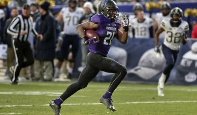 FILE - In this Dec. 28, 2016, file photo, Northwestern running back Justin Jackson (21) runs for a touchdown against Pittsburgh during the third quarter of the Pinstripe Bowl NCAA college football game, in New York. Jackson will finish his career as the FBS' No. 7 rusher if he matches last season's 1,524 yards. (AP Photo/Julie Jacobson, File)