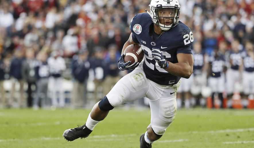 FILE - In this Jan. 2, 2017, file photo, Penn State Nittany Lions running back Saquon Barkley (26) looks for room to run against the USC Trojans during the first half of the Rose Bowl NCAA college football game, in Pasadena, Calif. Defending Big Ten champion Penn State returns a Heisman Trophy candidate at running back and a record-setting quarterback, and the Nittany Lions generally are regarded as one of the 10 best teams in the country. (AP Photo/Doug Benc, File)