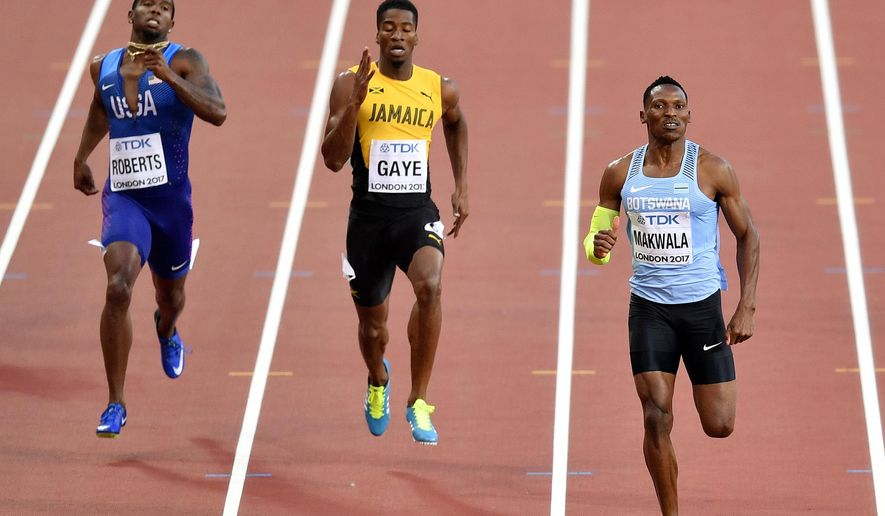 Botswana's Isaac Makwala, right, leads the field to the finish line in his heat of the Men's 400 meters during the World Athletics Championships in London Sunday, Aug. 6, 2017. (AP Photo/Martin Meissner)