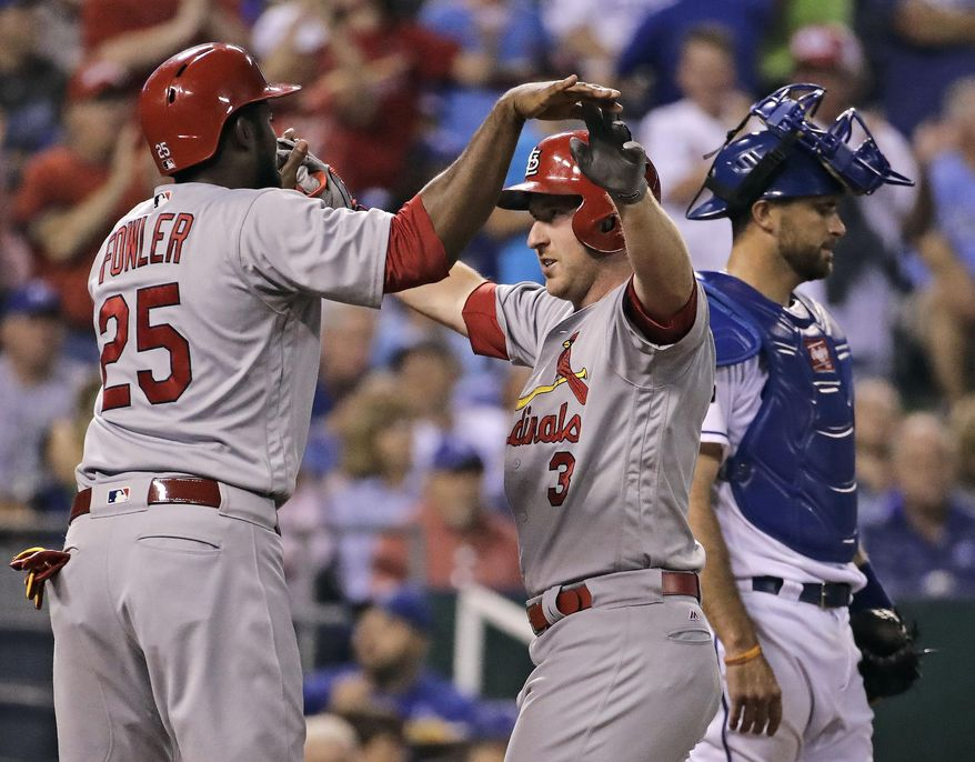 St. Louis Cardinals' Jedd Gyorko (3) celebrates with Dexter Fowler (25) after hitting a three-run home run during the fifth inning of a baseball game against the Kansas City Royals, Tuesday, Aug. 8, 2017, in Kansas City, Mo. (AP Photo/Charlie Riedel)