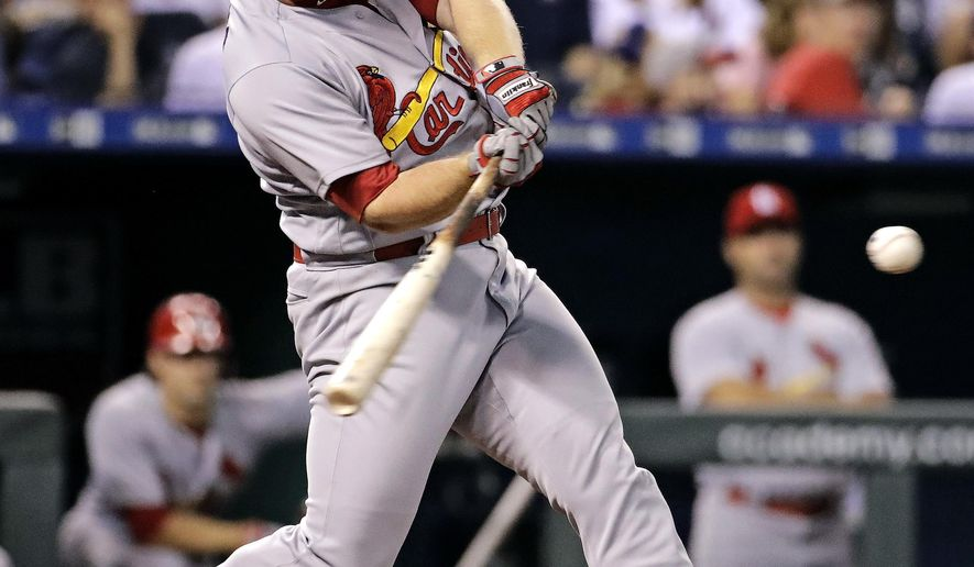 St. Louis Cardinals' Jedd Gyorko hits a three-run home run during the fifth inning of a baseball game against the Kansas City Royals, Tuesday, Aug. 8, 2017, in Kansas City, Mo. (AP Photo/Charlie Riedel)