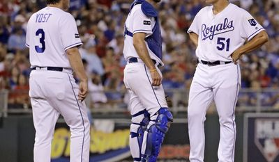 Kansas City Royals starting pitcher Jason Vargas stands on the mound before being taken out of the game by manager Ned Yost (3) during the fifth inning of a baseball game against the St. Louis Cardinals Tuesday, Aug. 8, 2017, in Kansas City, Mo. (AP Photo/Charlie Riedel)