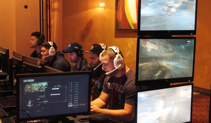 In this March 31, 2017 photo, video game players compete against one another in an esports tournament at Caesars casino in Atlantic City, N.J. Casinos are slowly embracing esports as a way to help their bottom line, but so far, the money is coming from renting hotel rooms to the young players and selling them food and drinks, not from turning them into gamblers. (AP Photo/Wayne Parry)