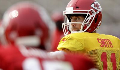 Kansas City Chiefs quarterback Alex Smith (11) looks for a receiver during NFL football training camp Monday, Aug. 7, 2017, in St. Joseph, Mo. (AP Photo/Charlie Riedel)