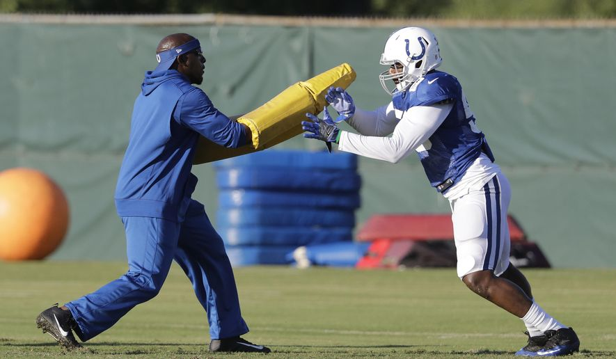 Indianapolis Colts defensive end Tarell Basham (58) runs a drill against Robert Mathis during practice at the NFL team's football training camp Tuesday, Aug. 8, 2017, in Indianapolis. (AP Photo/Darron Cummings)