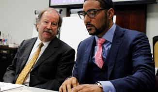 CORRECTS SPELLING OF LAST NAME TO MONNETT FROM MONETTE - Attorneys Charles Monette, left and Justin Bamberg, chat prior to a citizens review board hearing in Charlotte, N.C., on Tuesday, Aug. 8, 2017. The attorneys represent the estate of Keith Lamont Scott, who was shot and killed by a Charlotte-Mecklenburg police officer last September. The board said it found potential error in the departments decision that the shooting was justified and convened a second hearing to address the finding. (AP Photo/Skip Foreman)