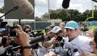 Miami Dolphins quarterback Jay Cutler speaks to the news media during an NFL football training camp, Tuesday, Aug. 8, 2017, in Davie, Fla. (AP Photo/Lynne Sladky)