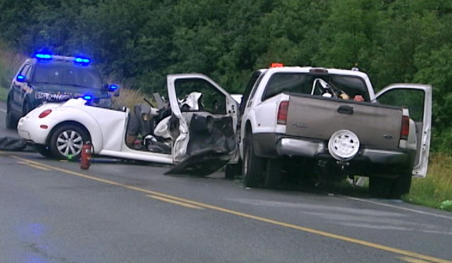 In this image taken from video on Monday, Aug. 7, 2017,  emergency personnel work at the scene of a fatal accident in Bridport, Vt. The four occupants of the car, who died, were not wearing seat belts. Vermont public safety officials on Tuesday, Aug. 8, urged drivers to buckle up and said state police would be more visible after a spike in fatal crashes in recent days have killed eight people. Seven of the eight killed were not wearing seat belts. (Jaime Brassard/WPTZ-TV via AP)