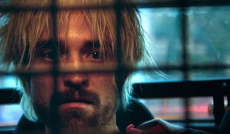 "This image released by A24 Films shows Robert Pattinson in ""Good Time."" (A24 via AP)"