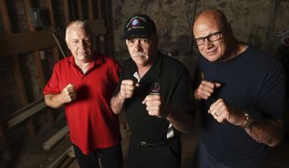 ADVANCE FOR SATURDAY, AUG. 12, 2017 Former boxers, from left, Russell Newton, Gary Holmgren and Gary Struss gather in the tiny basement where they trained during the 1970's, on Front Street in St. Paul, Minn. on July 26, 2017. Building owner Greg Brendemuehl plans to build a new boxing ring in the exact spot where the boxers trained and made names for themselves decades ago. (Scott Takushi/St. Paul Pioneer Press via AP)