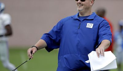 New York Giants head coach Ben McAdoo reacts after a play during NFL football training camp, Tuesday, Aug. 8, 2017, in East Rutherford, N.J. (AP Photo/Julio Cortez)