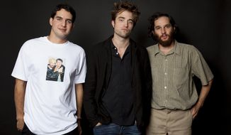 "In this Aug. 2, 2017 photo, co-director Ben Safdie, from left, actor Robert Pattinson, and co-director Joshua Safdie pose for a portrait to promote their film, ""Good Time"" at the Four Seasons Hotel in Los Angeles. (Photo by Rebecca Cabage/Invision/AP)"