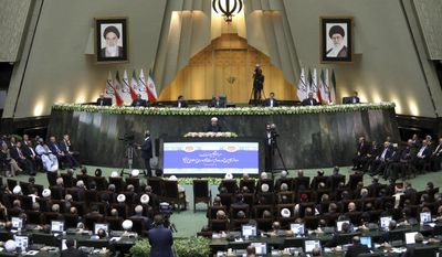 """Iran's President Hasan Rouhani, center, delivers a speech after his swearing-in ceremony for the second term in office, at the parliament in Tehran, Iran, Saturday, Aug. 5, 2017. Rouhani, 68, a moderate cleric who secured re-election on May 19, promised that his country will pursue a """"path of coexistence and interaction with the world."""" (AP Photo/Ebrahim Noroozi)"""