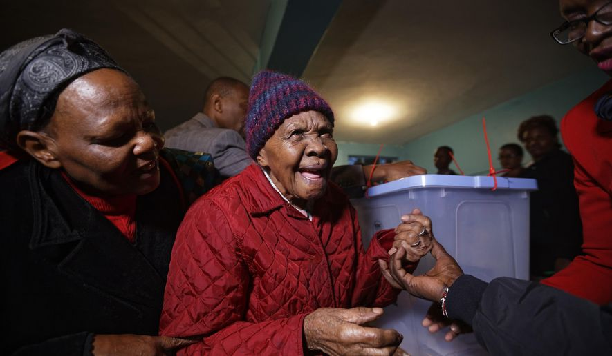 Lydia Gathoni Kiingati, 102, reacts after having her finger inked, after casting her vote just after dawn at a polling station in Gatundu, north of Nairobi, Kenya, Tuesday, Aug. 8, 2017. Kenyans are going to the polls to vote in a general election after a tightly-fought presidential race between incumbent President Uhuru Kenyatta and main opposition leader Raila Odinga. (AP Photo/Ben Curtis)