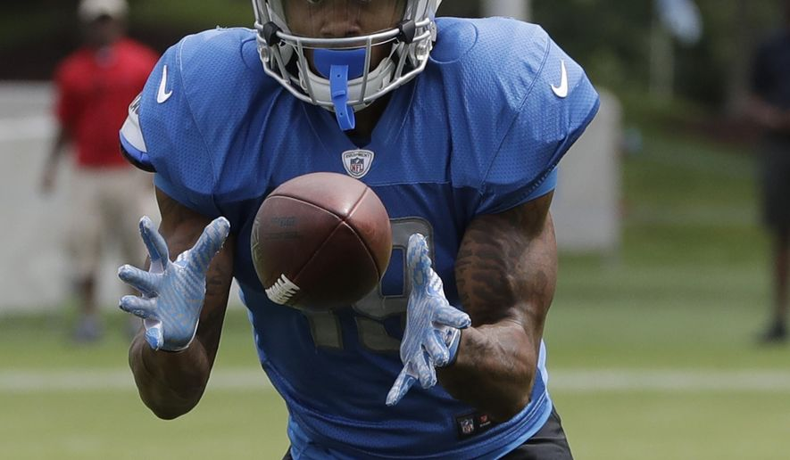 Detroit Lions wide receiver Kenny Golladay makes a catch during NFL football training camp, Monday, Aug. 7, 2017, in Allen Park, Mich. (AP Photo/Carlos Osorio)