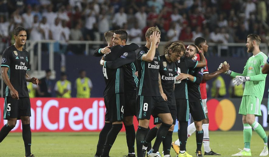 Real Madrid's Cristiano Ronaldo, center celebrates with teammates their win against Manchester Unitedduring the UEFA Super Cup final soccer match between Real Madrid and Manchester United at Philip II Arena in Skopje, Tuesday, Aug. 8, 2017. (AP Photo/Boris Grdanoski)