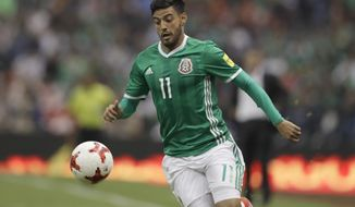FILE - In this March 24, 2017, file photo, Mexico's Carlos Vela drives the ball during a 2018 Russia World Cup qualifying soccer match against Costa Rica at Azteca Stadium in Mexico City. A person with knowledge of the deal tells The Associated Press that Mexican star Carlos Vela has reached a deal to join Los Angeles Football Club, the expansion MLS franchise due to begin play in March. The person spoke to the AP on condition of anonymity Tuesday, Aug. 8, 2017, because LAFC hasn't formally announced its first designated player signing. (AP Photo/Rebecca Blackwell, File)