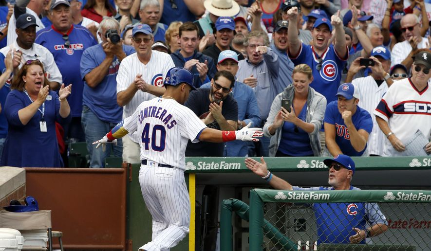 Chicago Cubs' Willson Contreras, left, celebrates with manager Joe Maddon after hitting a solo home run during the fourth inning of a baseball game against the Washington Nationals, Sunday, Aug. 6, 2017, in Chicago. (AP Photo/Nam Y. Huh)