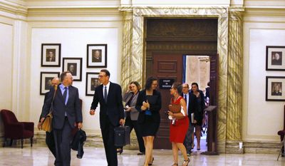 Former U.S. Attorney Robert McCampbell, second from left, who represents Phillip Morris USA Inc., R.J Reynolds Tobacco Co. and others, leaves the Oklahoma Supreme Court following oral arguments in connection with three lawsuits that challenge revenue-raising measures adopted by lawmakers, in Oklahoma City, Tuesday, Aug. 8, 2017. (AP Photo/Sue Ogrocki)