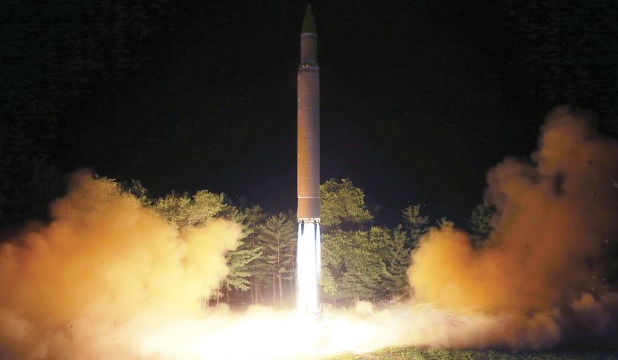 FILE - In this July 28, 2017, file photo distributed by the North Korean government on Saturday, July 29, 2017, shows what was said to be the launch of a Hwasong-14 intercontinental ballistic missile at an undisclosed location in North Korea. A U.S. official says American intelligence agencies have assessed that North Korea has developed a nuclear warhead that could be fitted onto an intercontinental ballistic missile. The official says the Defense Intelligence Agency assessment, first reported by The Washington Post on Aug. 8, says North Korea has made a miniaturized nuclear warhead, but that it would still have to hurdle other technical issues before it could successfully deliver such a weapon. (Korean Central News Agency/Korea News Service via AP, File)