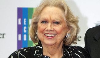 In this Dec. 7, 2013, file photo, Barbara Cook arrives at the State Department for the Kennedy Center Honors gala dinner in Washington. Cook, whose shimmering soprano made her one of Broadway's leading ingenues and later a major cabaret and concert interpreter of popular American song, has died. She was 89. (AP Photo/Kevin Wolf, File)