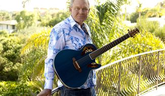 "FILE - In this July 27, 2011 photo, musician Glen Campbell poses for a portrait in Malibu, Calif. Campbell, the grinning, high-pitched entertainer who had such hits as ""Rhinestone Cowboy"" and spanned country, pop, television and movies, died Tuesday, Aug. 8, 2017. He was 81. Campbell announced in June 2011 that he had been diagnosed with Alzheimer's disease. (AP Photo/Matt Sayles, File)"