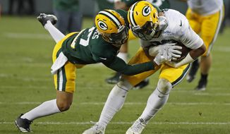 Green Bay Packers' Richard Rodgers, right, is hit by Josh Jones after making a catch during NFL football training camp Saturday, Aug 5, 2017, in Green Bay, Wis. (AP Photo/Matt Ludtke)