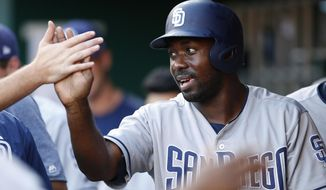 San Diego Padres left fielder Jose Pirela celebrates a score on a wild pitch by Cincinnati Reds starting pitcher Sal Romano during the first inning of a baseball game, Tuesday, Aug. 8, 2017, in Cincinnati. (AP Photo/Gary Landers)